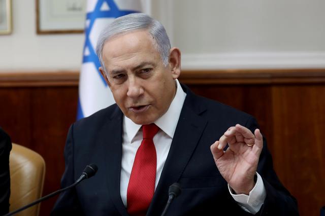 FILE PHOTO: Israeli Prime Minister Benjamin Netanyahu gestures while speaking during the weekly cabinet meeting in Jerusalem October 27, 2019. Gali Tibbon/Pool via REUTERS/File Photo