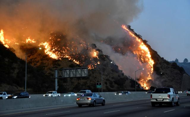FILE PHOTO: The Getty Fire burns near the Getty Center along the 405 freeway north of Los Angeles, California, U.S. October 28, 2019. REUTERS/  Gene Blevins/File Photo
