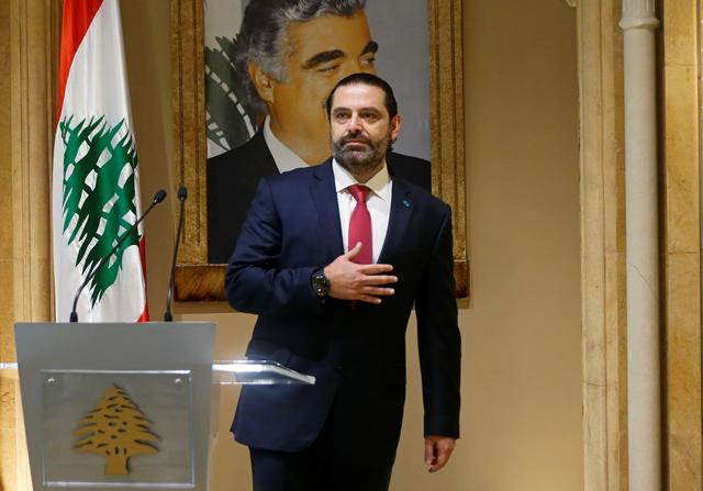 FILE PHOTO: Lebanon's Prime Minister Saad al-Hariri gestures as he leaves after delivering his address in Beirut, Lebanon October 29, 2019. REUTERS/Mohamed Azakir/File Photo