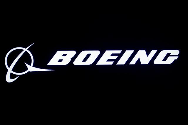 FILE PHOTO: The Boeing logo is displayed on a screen, at the New York Stock Exchange (NYSE) in New York, U.S., August 7, 2019. REUTERS/Brendan McDermid