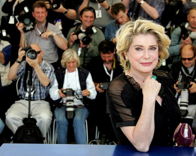 FILE PHOTO: French actress Catherine Deneuve smiles during a photo call at the 58th Cannes Film Festival May 12, 2005. - REUTERS/Eric Gaillard/File Photo