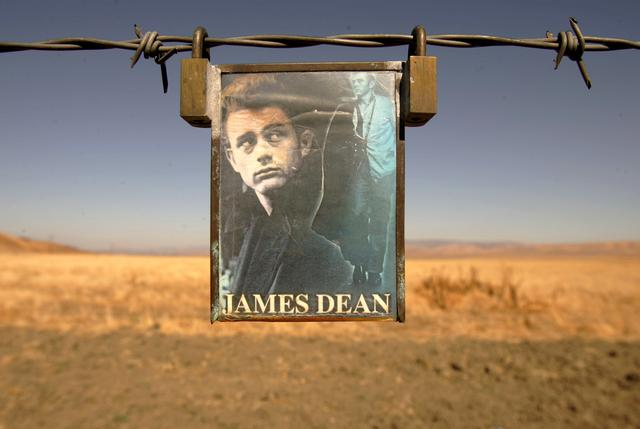 FILE PHOTO: A portrait of U.S. actor James Dean hangs from a fence near the intersection of Highways 46 and 41 near Cholame, California September 30, 2005/File Photo