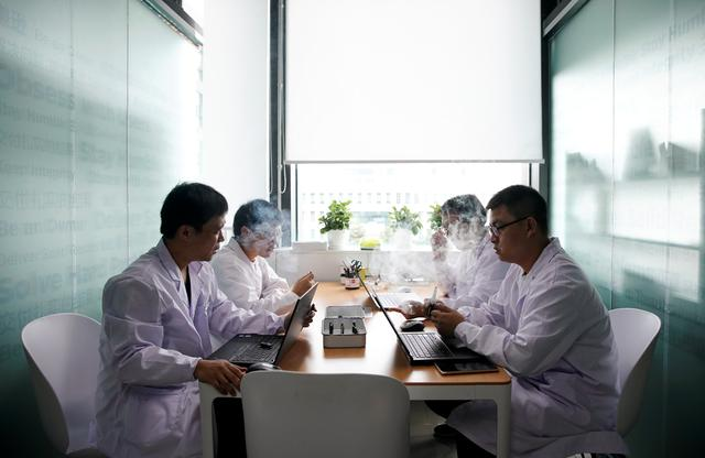 Engineers test e-cigarettes at an evaluation room of Chinese e-cigarette company Relx in Shenzhen, Guangdong province, China July 22, 2019. REUTERS/Aly Song/Files