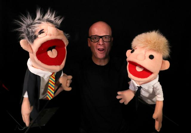 """Belgian music producer Michael Schack, creator of the track """"Order"""", which mixes dance music with former speaker of British House of Commons John Bercow's trademark ripostes, poses with puppets depicting Bercow and British Prime Minister Boris Johnson, in his studio in Antwerp, Belgium November 6, 2019.   REUTERS/Yves Herman"""