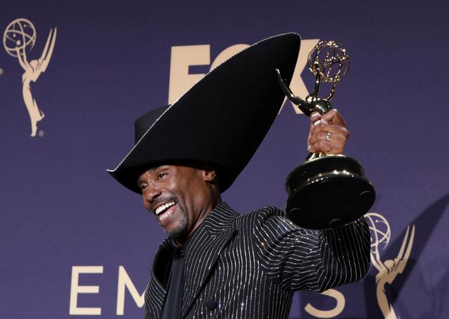 """FILE PHOTO: 71st Primetime Emmy Awards - Photo Room – Los Angeles, California, U.S., September 22, 2019 - Billy Porter poses backstage with his Outstanding Lead Actor in a Drama Series for """"Pose"""". REUTERS/Monica Almeida/File Photo"""