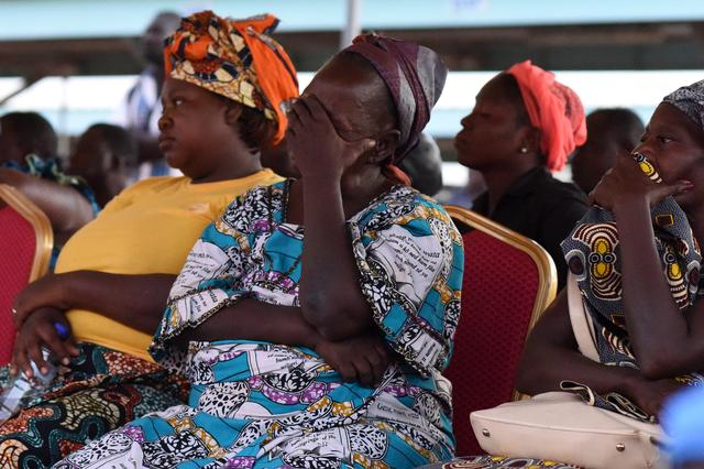 Family members of victims of an ambush on workers near a Canadian-owned mine, react during their meeting with officials in Ouagadougou, Burkina Faso November 7, 2019. REUTERS/Anne Mimault