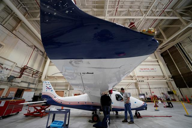 Technicians work on NASA's first all-electric plane, the X-57 Maxwell,  at NASA's Armstrong Flight Research Center at Edwards Air Force Base, California, U.S., November 8, 2019.  REUTERS/Mike Blake