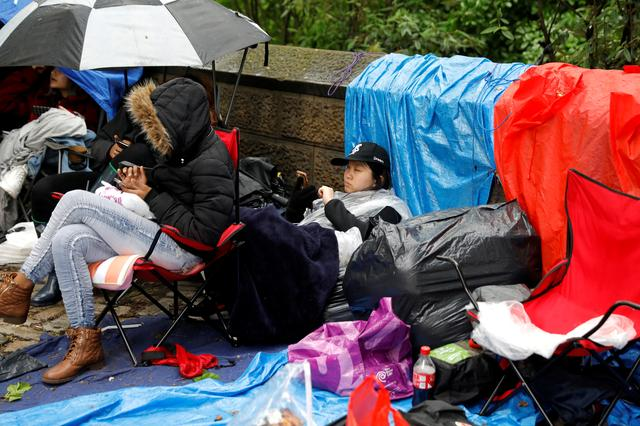 FILE PHOTO: File picture of fans of the Korean K-Pop band BTS waiting in the rain outside Central Park in New York a day ahead of a concert performance. New York City, New York, U.S., May 14, 2019. REUTERS/Mike Segar/File Photo