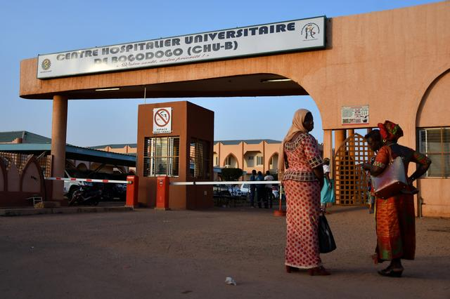 FILE PHOTO: Women stand outside Bogodogo hospital where officials met with family members of victims of an ambush on workers near a Canadian-owned mine, in Ouagadougou, Burkina Faso November 7, 2019. REUTERS/Anne Mimault