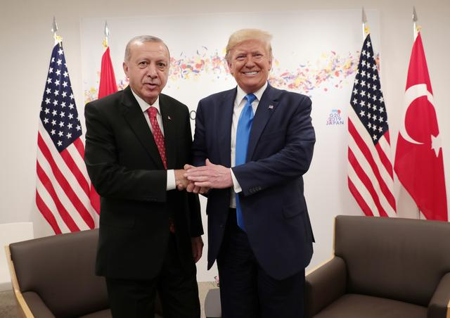 FILE PHOTO: Turkey's President Tayyip Erdogan shakes hands with U.S. President Donald Trump during their bilateral meeting on the sidelines of the G20 leaders summit in Osaka, Japan, June 29, 2019. Murat Cetinmuhurdar/Turkish Presidential Press Office/Handout via REUTERS/File Photo
