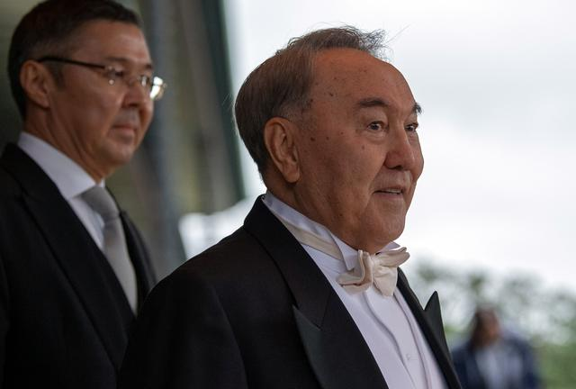 FILE PHOTO: Kazakhstan's President Nursultan Nazarbayev leaves after the enthronement ceremony of Japan's Emperor Naruhito at the Imperial Palace in Tokyo, Japan October 22, 2019.  Carl Court/Pool via REUTERS/File Photo