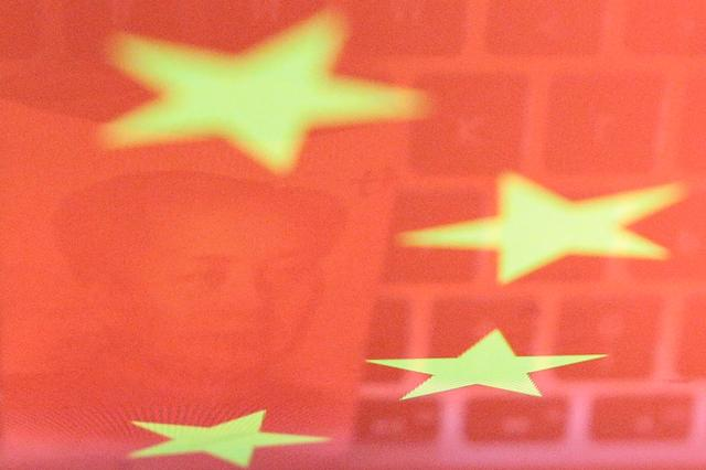 FILE PHOTO: A China yuan banknote featuring late Chinese chairman Mao Zedong and a computer keyboard are seen reflected on an image of Chinese flag in this illustration picture taken November 1, 2019.  REUTERS/Florence Lo/Illustration