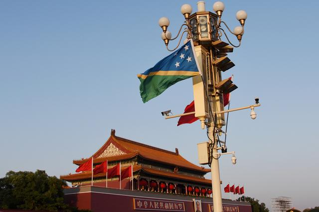 FILE PHOTO: The national flags of Solomon Islands and China flutter at Tiananmen Square in Beijing, China October 7, 2019. REUTERS/Stringer/File Photo