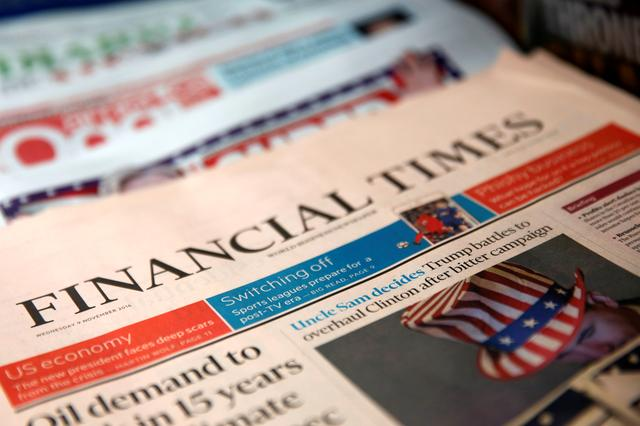 FILE PHOTO: The cover of the Financial Times newspaper is seen with other papers at a news stand in New York U.S., November 9, 2016. REUTERS/Shannon Stapleton