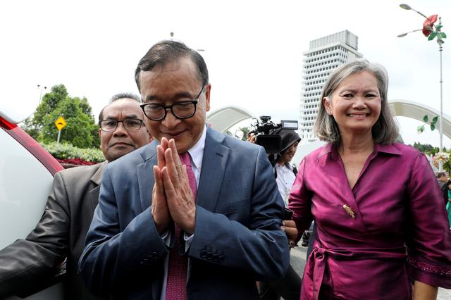 Self-exiled Cambodian opposition party founder Sam Rainsy gestures as he leaves the Parliament House along Mu Sochua, Deputy President of the Cambodia National Rescue Party (CNRP), in Kuala Lumpur, Malaysia, November 12, 2019. REUTERS/Lim Huey Teng