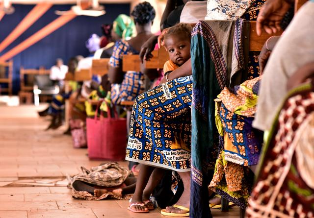FILE PHOTO: Displaced protestants, who fled Dablo and its surroundings, attend a church service in the city of Kaya, Burkina Faso May 16, 2019. REUTERS/Anne Mimault