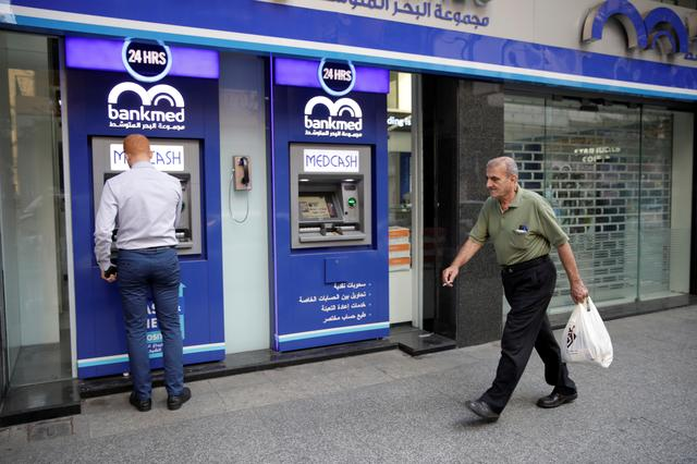 A man walks past a closed bank office in Beirut, Lebanon November 12, 2019. REUTERS/Andres Martinez Casares