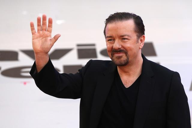 FILE PHOTO: Actor and director Ricky Gervais poses for photographers at the world premiere of his film David Brent Life on the Road in London, Britain August 10, 2016. REUTERS/Neil Hall