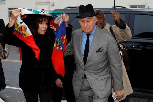 Roger Stone, former campaign adviser to U.S. President Donald Trump, arrives with his wife Nydia for the continuation of his criminal trial on charges of lying to Congress, obstructing justice and witness tampering at U.S. District Court in Washington, U.S., November 12, 2019. REUTERS/Yuri Gripas