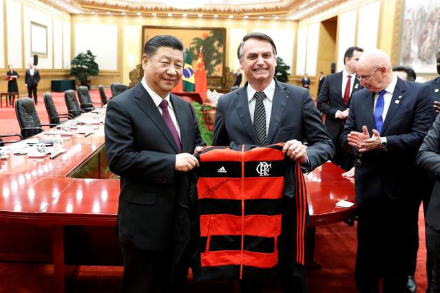 FILE PHOTO: China's President Xi Jinping revives a gift from Brazil's President Jair Bolsonaro at the end of the signing ceremony at the Great Hall of the People in Beijing, China October 25, 2019. Yukie Nishizawa/Pool via REUTERS/