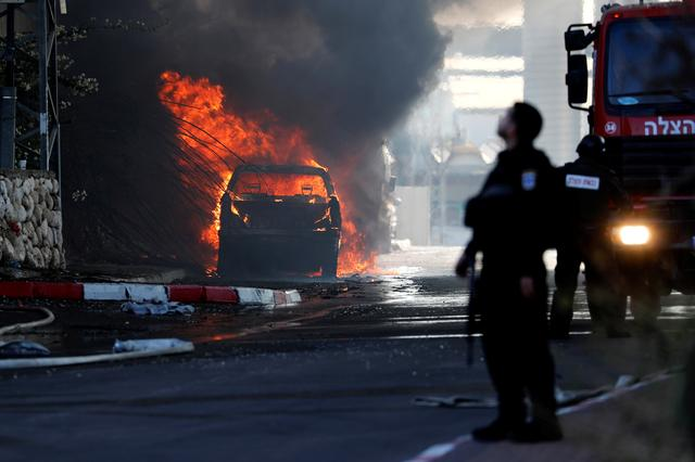 A vehicle burns after a factory caught on fire in Sderot, southern Israel November 12, 2019. REUTERS/Ammar Awad