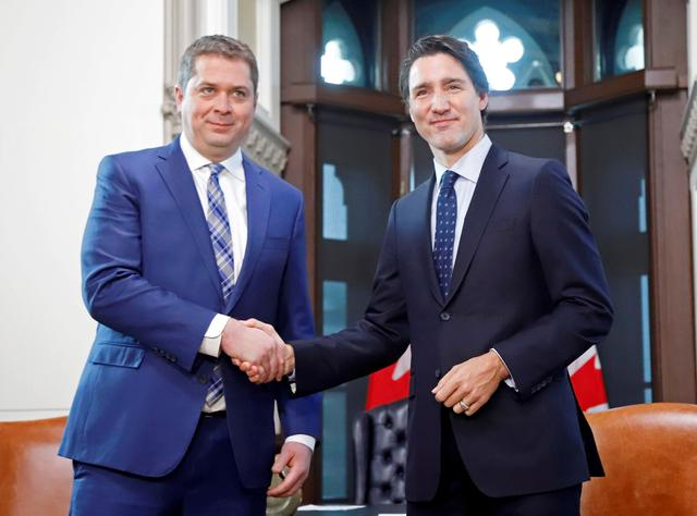 Canada's Prime Minister Justin Trudeau meets with Conservative Party leader and Leader of the Official Opposition Andrew Scheer on Parliament Hill in Ottawa, Ontario Canada November 12, 2019.  REUTERS/Patrick Doyle