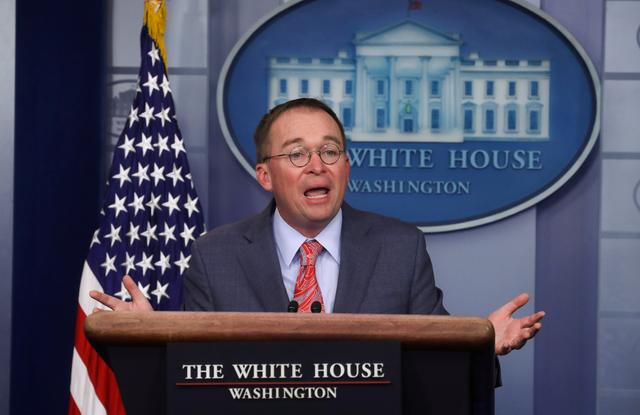 FILE PHOTO: Acting White House Chief of Staff Mick Mulvaney answers questions from reporters during a news briefing at the White House in Washington, U.S., October 17, 2019. REUTERS/Leah Millis