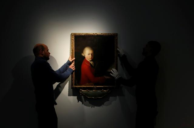 Workers install a portrait due to be sold at auction by Christie's on November 27 which depicts composer Wolfgang Amadeus Mozart as a teenager, painted in January 1770, and attributed to Veronese master Gaimbettino Cignaroli, in Paris, November 12, 2019. REUTERS/Christian Hartmann