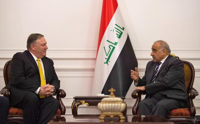 FILE PHOTO: U.S. Secretary of State Mike Pompeo talks with Iraqi Prime Minister Adel Abdul-Mahdi in Baghdad, during a Middle East tour, Iraq, January 9, 2019.  Andrew Caballero-Reynolds/Pool via REUTERS/File Photo
