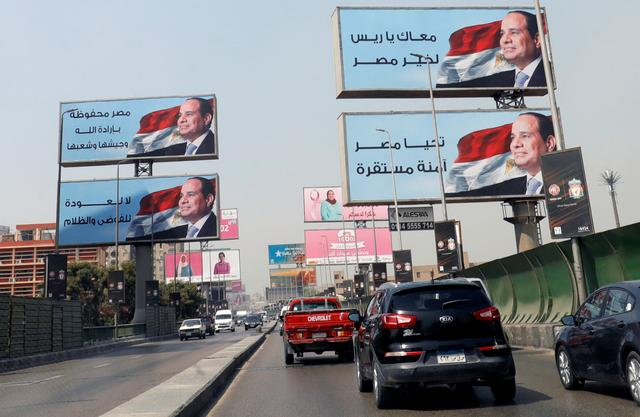 FILE PHOTO: Cars move along the '6th October Bridge' near banners of Egyptian President Abdel Fattah al-Sisi, in Cairo, Egypt October 2, 2019. REUTERS/Amr Abdallah Dalsh/File Photo