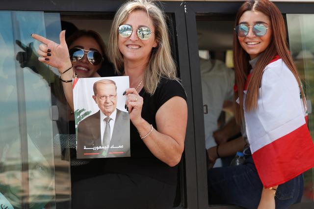 A supporter of Lebanon's President Michel Aoun hold his poster during a rally in Baabda near Beirut, Lebanon, November 3, 2019. REUTERS/Goran Tomasevic
