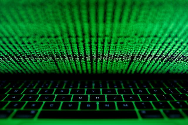 FILE PHOTO: A computer keyboard lit by a displayed cyber code is seen in this illustration picture taken on March 1,  2017. REUTERS/Kacper Pempel/Illustration/File Photo