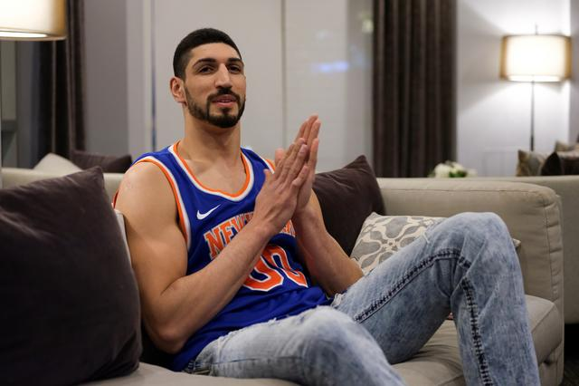 FILE PHOTO: Turkish NBA player Enes Kanter watches the final minutes of the game as his team, the New York Knicks, plays the Washington Wizards at the O2 Arena in London on his television in White Plains, New York, U.S., January 17, 2019. REUTERS/Caitlin Ochs