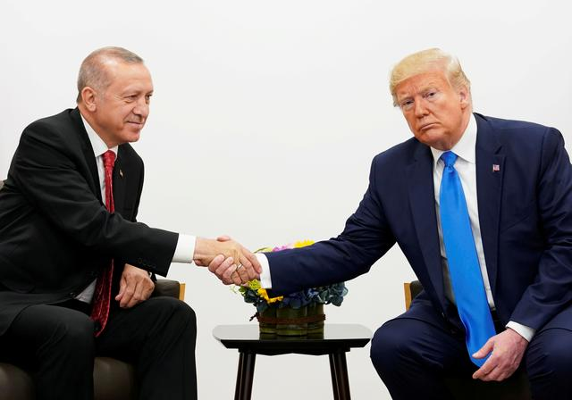 FILE PHOTO: U.S. President Donald Trump shakes hands during a bilateral meeting with Turkey's President Tayyip Erdogan during the G20 leaders summit in Osaka, Japan, June 29, 2019. REUTERS/Kevin Lamarque/File Photo