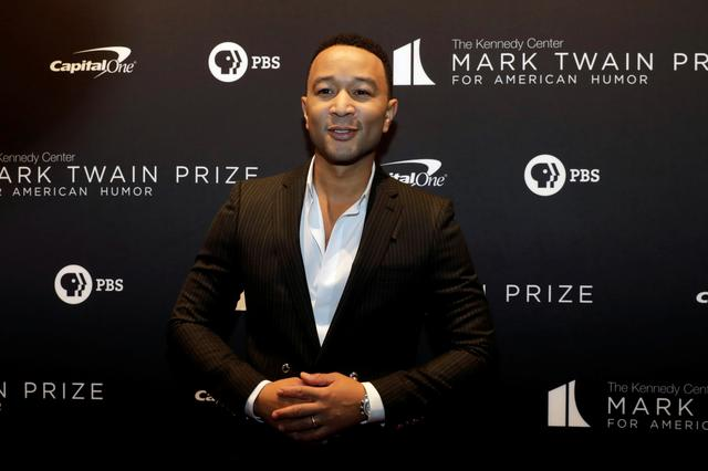 FILE PHOTO: John Legend arrives ahead of comedian Dave Chappelle receiving the Mark Twain Prize for American Humor at the Kennedy Center in Washington, U.S., October 27, 2019. REUTERS/Yuri Gripas/File Photo