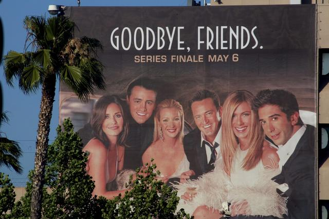 "FILE PHOTO: The cast of the popular comedy television series ""Friends,"" which will end its ten year run on May 6, 2004, are pictured on a giant billboard promoting the series finale, at the NBC television network office in Burbank, California, May 3, 2004. Cast members (L-R) are Courteney Cox Arquette as Monica, Matt Le Blanc as Joey, Lisa Kudrow as Pheobe, Matthew Perry as Chandler, Jennifer Aniston as Rachel and David Schwimmer as Ross. PHOTOGRAPH TAKEN MAY 3 REUTERS/Fred Prouser"