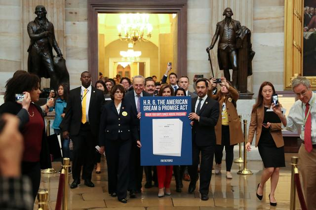 U.S. House Speaker Nancy Pelosi (D-CA) and Senate Minority Leader Chuck Schumer (D-NY) lead a symbolic march to deliver the Dream Act, addressing young immmigrants who were brought to the U.S. as children, to Senate Majority Leader Mitch McConnell's (R-KY) office at the U.S. Capitol in Washington, U.S., November 12, 2019.  REUTERS/Jonathan Ernst