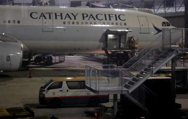 FILE PHOTO: Workers service a Cathay Pacific flight at Hong Kong International Airport, China September 3, 2019. Picture taken September 3, 2019. REUTERS/Amr Abdallah Dalsh