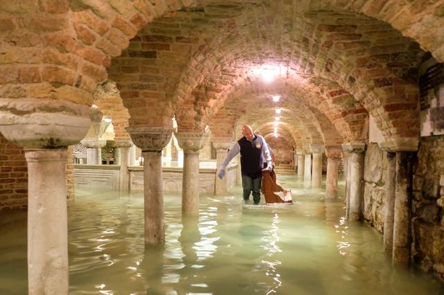 The flooded crypt of St Mark's Basilica is pictured during an exceptionally high water levels in Venice, Italy November 13, 2019. REUTERS/Manuel Silvestri