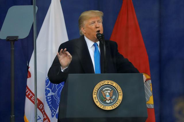 FILE PHOTO: U.S. President Donald Trump delivers remarks at a Veterans Day Parade and Wreath Laying ceremony in Manhattan, New York City, U.S., November 11, 2019. REUTERS/Andrew Kelly