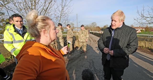 British Prime Minister Boris Johnson talks to a woman during a visit following recent flooding in Stainforth, Doncaster, Britain November 13, 2019. Danny Lawson/Pool via REUTERS