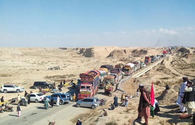 Vehicles are seen after they were stopped on a highway linking the country's southwest region with Afghanistan, during the second phase of so-called Azadi March (Freedom March), called by the opposition to protest against the government of Prime Minister Imran Khan, in Qilla Abdullah near Quetta, Pakistan November 13, 2019. REUTERS/Stringer