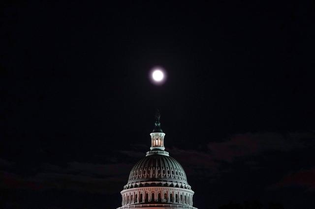 On the eve of the start of public hearings in the impeachment inquiry of U.S. President Donald Trump, the moon rises over the U.S. Capitol in Washington, U.S., November 12, 2019.  REUTERS/Jonathan Ernst