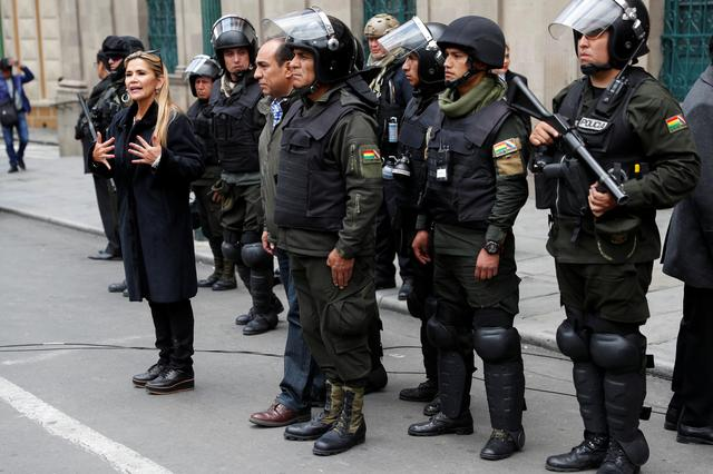 Bolivian Interim President Jeanine Anez takes part in a ceremony with the police in front of the Presidential Palace, in La Paz, Bolivia November 13, 2019. REUTERS/Carlos Garcia Rawlins