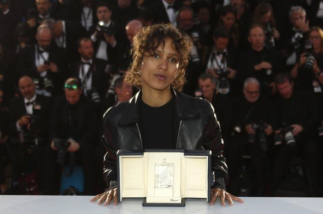 "FILE PHOTO: 72nd Cannes Film Festival - Photocall after Closing ceremony - Cannes, France, May 25, 2019. Director Mati Diop, Grand Prix award winner for her film ""Atlantics"" (Atlantique) poses. REUTERS/Regis Duvignau"