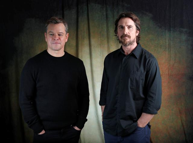 "FILE PHOTO: Cast members Christian Bale (R) and Matt Damon pose for a portrait while promoting the film ""Ford v Ferrari"" in Los Angeles, California, U.S., November 6, 2019. REUTERS/Mario Anzuoni"