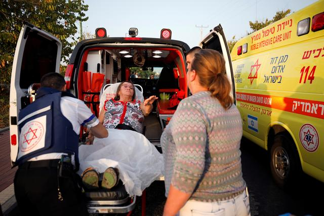 An injured woman is evacuated to hospital after a rocket was fired from Gaza into Israel, in Ashkelon, southern Israel November 13, 2019. REUTERS/Amir Cohen