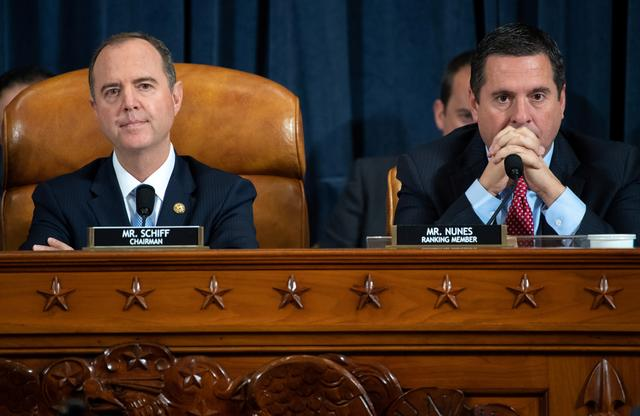 Chairman Adam Schiff (L), Democrat of California, and Ranking Member Devin Nunes (R), Republican of California, during the first public hearings held by the House Permanent Select Committee on Intelligence as part of the impeachment inquiry into U.S. President Donald Trump, on Capitol Hill in Washington, DC, U.S., November 13, 2019.    Saul Loeb/Pool via REUTERS