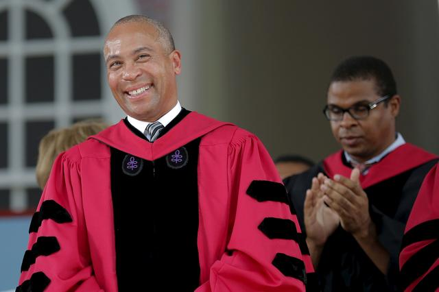 FILE PHOTO: Former Massachusetts Governor Deval Patrick stands to receive an honorary Doctor of Laws degree during the 364th Commencement Exercises at Harvard University in Cambridge, Massachusetts May 28, 2015.    REUTERS/Brian Snyder