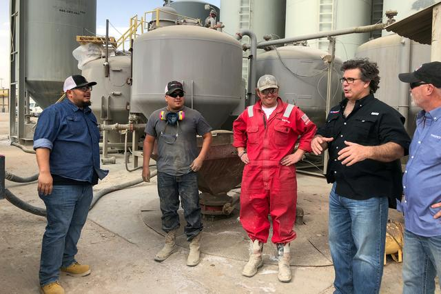 FILE PHOTO: Dale Redman, CEO of ProPetro, speaks with workers on a yard where he stores and manages equipment for his Midland fracking services company in Midland, Texas, U.S., on April 12, 2018.   Picture taken April 12, 2018.   REUTERS/Ann Saphir